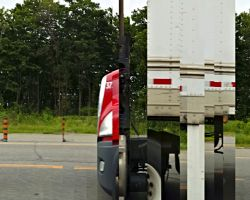 Photo made with panorama from a moving car while passing a truck
